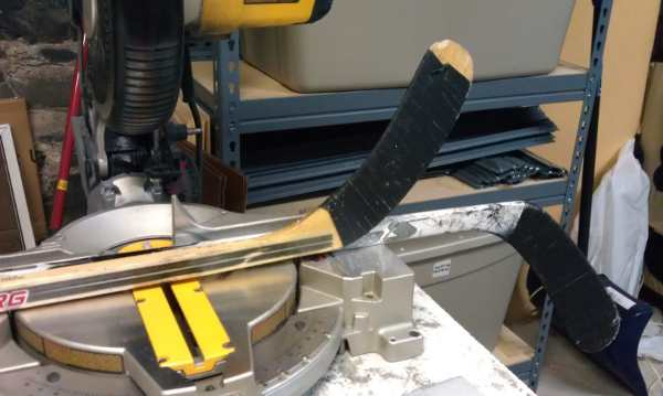 cutting composite hockey sticks on mitre saw