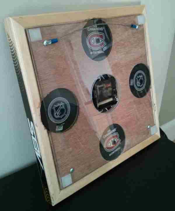 Hockey stick clock backing